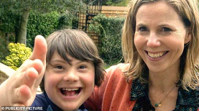 Mothers of children with the syndrome, including actress Sally Phillips (pictured with son Olly, 15), had accused the NHS of pressuring pregnant women into aborting children with Down's