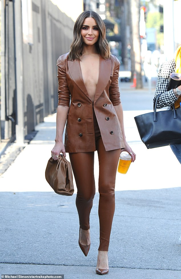 Risky!Olivia Culpo risked a wardrobe malfunction in Los Angeles on Monday when she opted to go braless in a leather power suit for a meeting