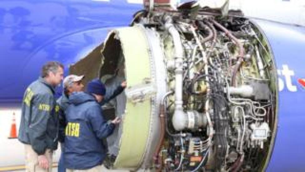 NTSB investigators examining damage to the engine of the Southwest Airlines plane in this image released from Philadelphia, Pennsylvania, April 17, 2018