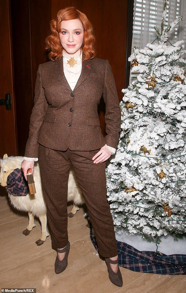 Happy holidays: Christina Hendricks doesn't need a man by her side (or her ex Geoffrey Arend) as she kicks off the holiday season by heading off to a jolly event