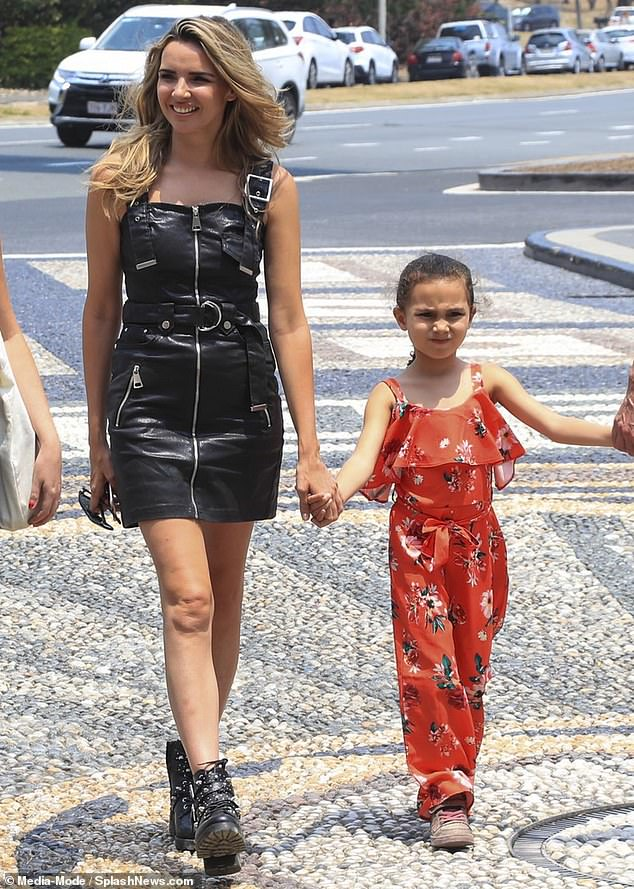 Stepping out:A roller-coaster three-week stay in the Australian jungle was forgotten as Nadine Coyle relaxed with five-year old daughter Anaíya in Queensland on Monday morning
