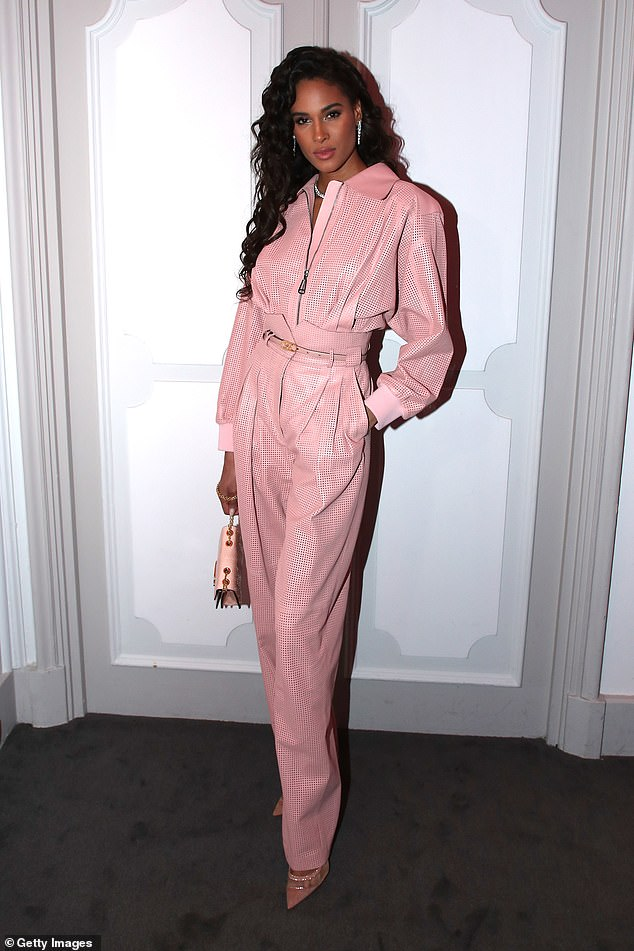 Glamour: French model Cindy Bruna, 25, cut a stylish figure in a pink long-sleeved jumpsuit
