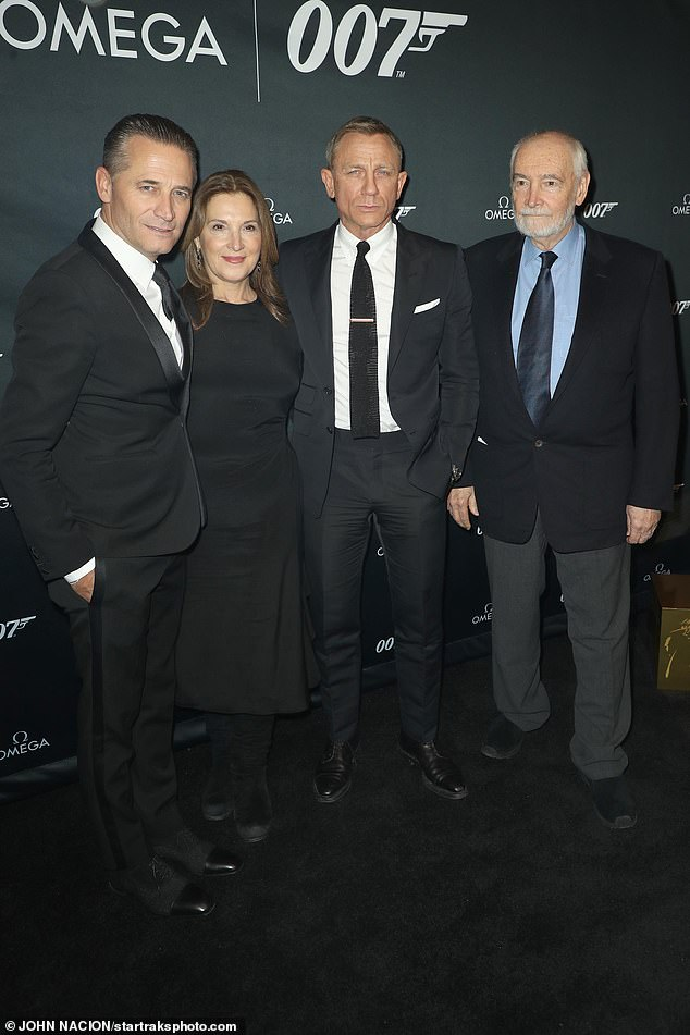 In good company: The Casino Royale star joined (L-R) Omega's CEO Raynald Aeschlimann and No Time To Die producers Barbara Broccoli and Michael G. Wilson