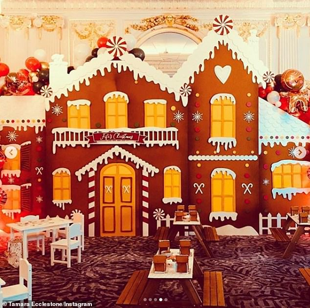 Treat: The awe-inspiring party featured a giant replica of a gingerbread house decorated with balloons and candy canes