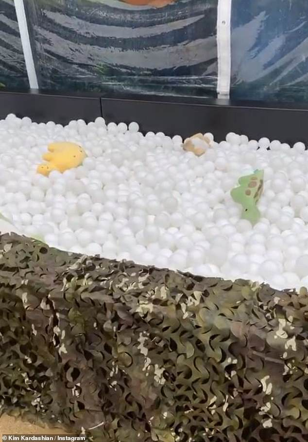 Thought of everything: Kim created a ball pit with camo coverings and plush dinosaur stuffed animals