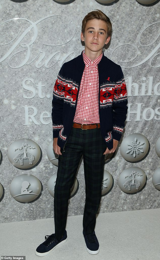 This Is Us: Parker Bates who stars in This Is Us showed off his plaid pants and holiday sweater for the event