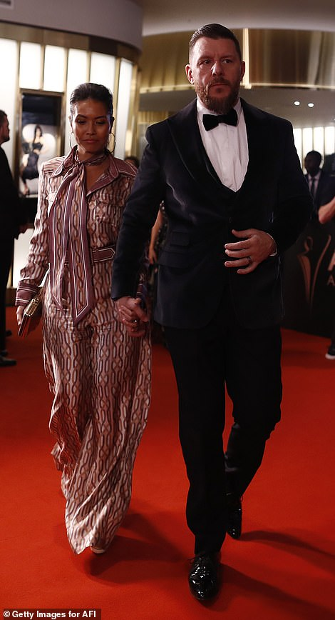 On the move:After posing for photos alongside his glamorous wife, the couple made their way inside for the awards show, walking hand-in-hand down the red carpet