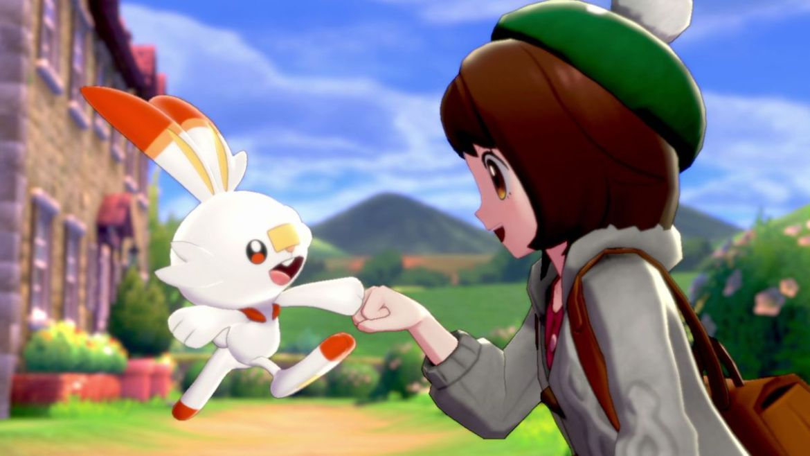 Scorbunny fist-bumps a Pokemon trainer in a screenshot from Pokémon Sword/Pokémon Shield
