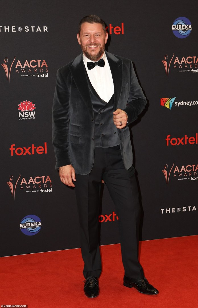 Suits him: Manu Fieldel was also on hand for the awards show, and looked dashing in a three-piece suit, which featured a velvet waistcoat and blazer