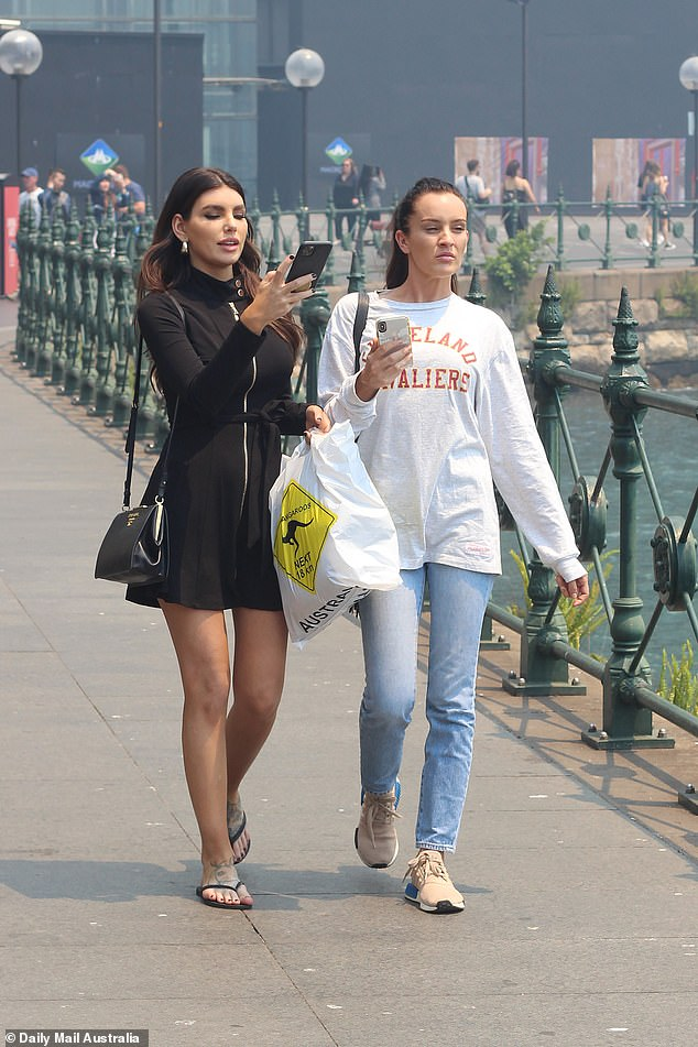Casual:Ines dressed casually as they explored Circular Quay, oozing laid-back style in a pair of slim jeans, a baggy sweater and pair of trendy Adidas sneakers