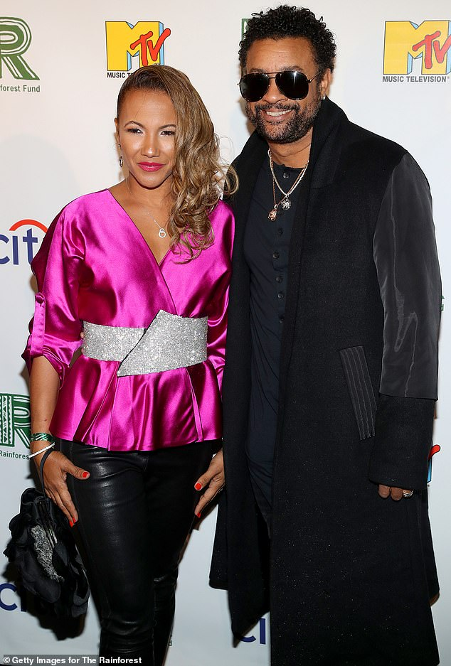Fuchsia fierce: Shaggy rocked a black top coat with vinyl sleeves as wife Rebecca Packer donned a satin fuchsia wrap top with a sparkling silver belt