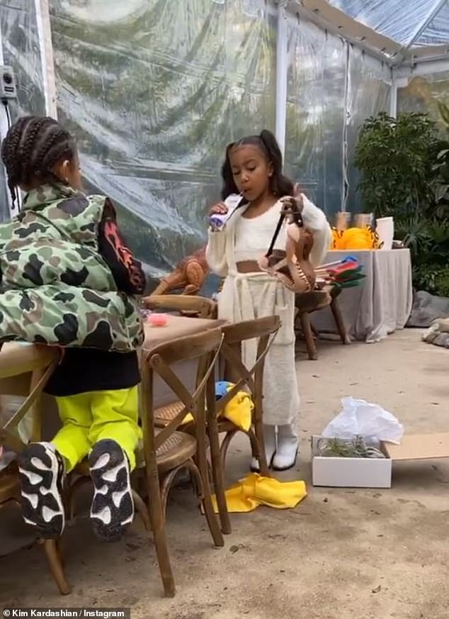 Cutie:The six-year-old little girl looked fashion forward in a crop top and pants as she joined her siblings to celebrate her brother Saint's birthday