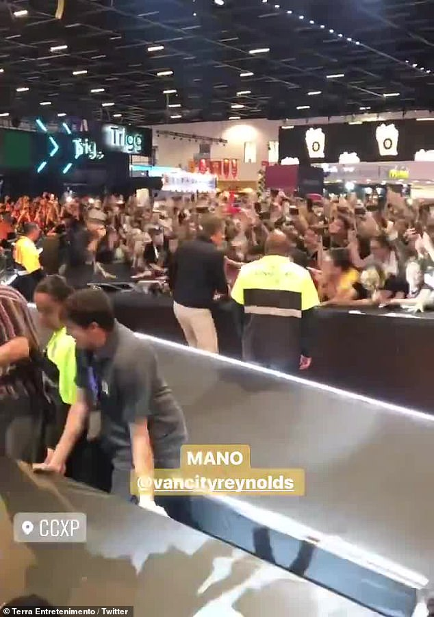 Working the crowd: After working the audience from the stage, the Deadpool star jumped to the ground and approached the raucous crowd who were yelling and screaming