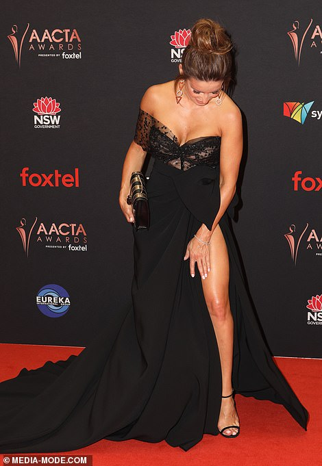 Doing the splits: Ada left little to the imagination in her daring ensemble, which featured a thigh-high split up one side
