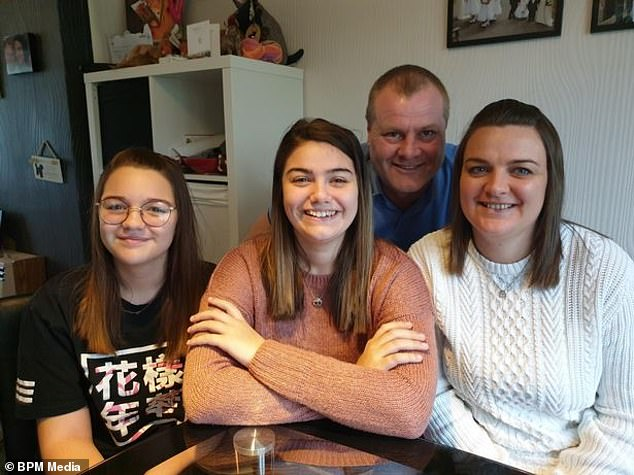 Miss Worley, pictured with her sister Lexi, stepfather Ade and mother, Claire, had surgery in Birmingham earlier this year to remove her cancer and then spent six days recovering in intensive care