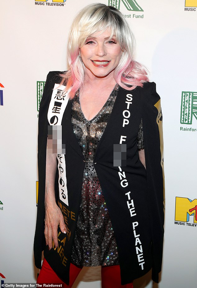 Statement piece: Debbie Harry served punk chic in a black vest with a built-in cape that read 'stop f***ing the planet' in several languages