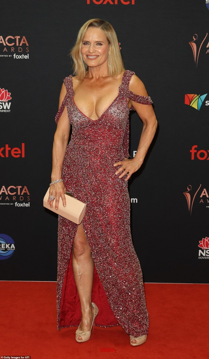 Taking the plunge:Shaynna Blaze also risked a red-faced moment at the awards show, stepping out in a sparkly red dress with a plunging neckline