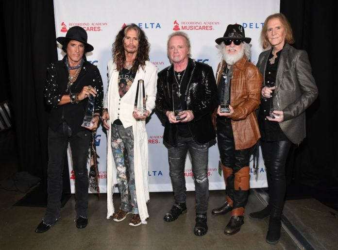 LOS ANGELES, CALIFORNIA - JANUARY 24: (L-R) Honorees Joe Perry, Steven Tyler, Joey Kramer, Brad Whitford, and Tom Hamilton of music group Aerosmith, recipients of the Person of the Year award, attends MusiCares Person of the Year honoring Aerosmith at West Hall at Los Angeles Convention Center on January 24, 2020 in Los Angeles, California. (Photo by Kevin Mazur/Getty Images for The Recording Academy)