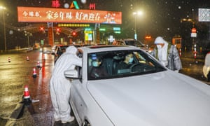 Medical staff at a checkpoint in China's Shandong province