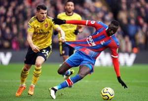 Cheikhou Kouyate is hauled back by Arsenal's Granit Xhaka.