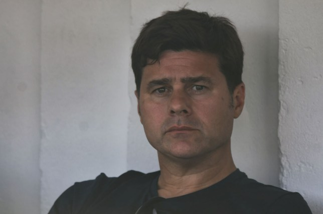 Manchester United managerial target Mauricio Pochettino sits on in the stands