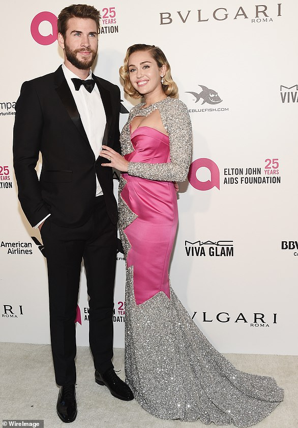 Over: Miley announced in August that she has separated from her husband Liam Hemsworth, with whom she had a decade-long on-off romance