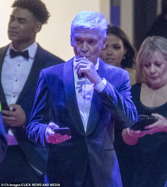 Smoking away: Phillip Schofield was puffing on a vape as he led the stars loitering in the smoking area during theNational TV Awards on Tuesday evening