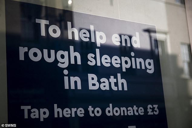A branch of the Nationwide Building Society in Somerset has put up a 'smart window poster' that allows passers-by to make contactless donations to the homeless