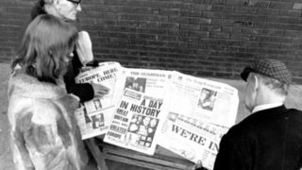 People read newspapers declaring news of British entry into the EEC