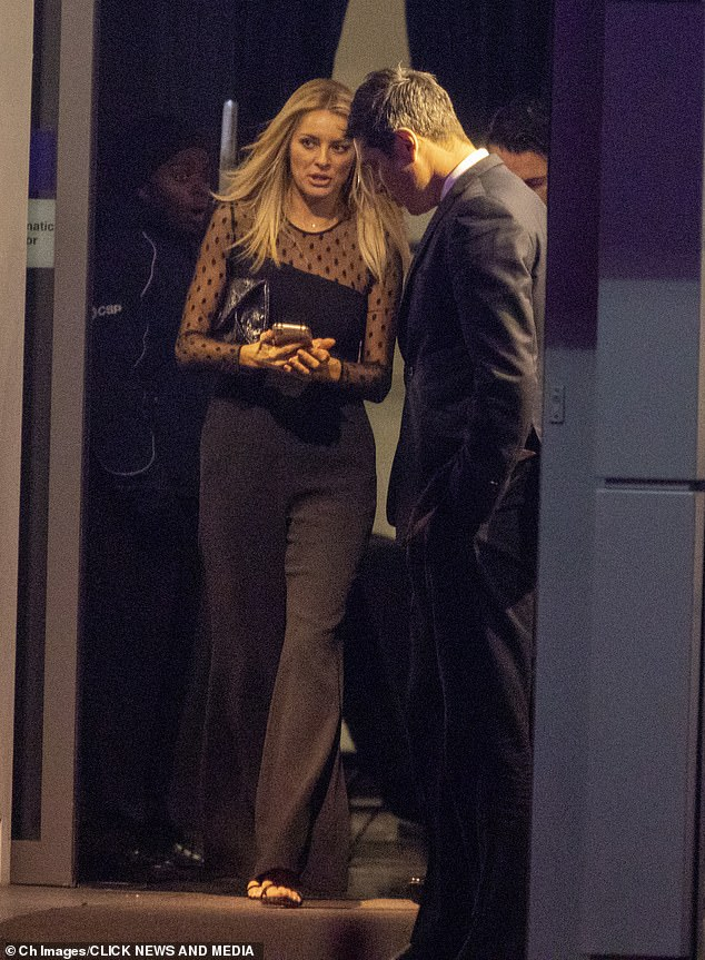 Lady in black:Strutting out of the bash after a rare red carpet appearance was loved-up couple Tess Daly and Vernon Kay who both sported stylish all-black