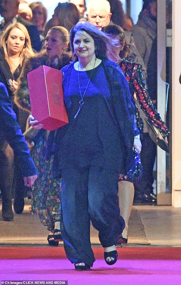 Stunner:Ruth Jones was a vision as she left the bash in her head-to-toe black look while clutching a large red box which contained the gong she won for Gavin And Stacey