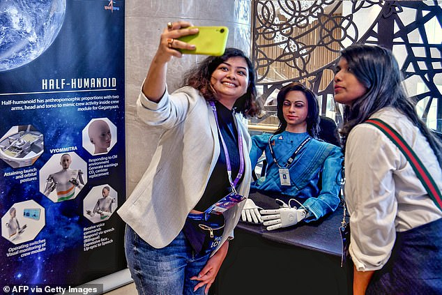 Scientists showed Vyommitra off a media event on Wednesday where she greeted spectators with 'Hi, I'm Vyommitra the first prototype of half humanoid'
