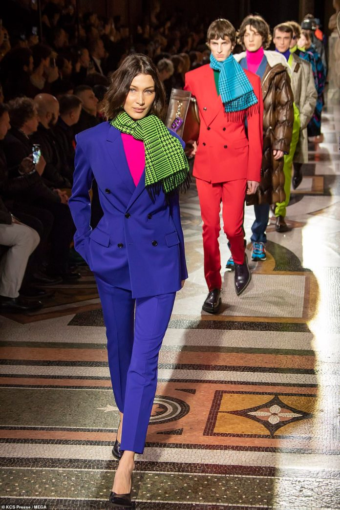 Superstar: Bella led the line of models into the fashion show as they donned an array of colourful suits and printed scarves for the Autumn/Winter 2020-2021 collection