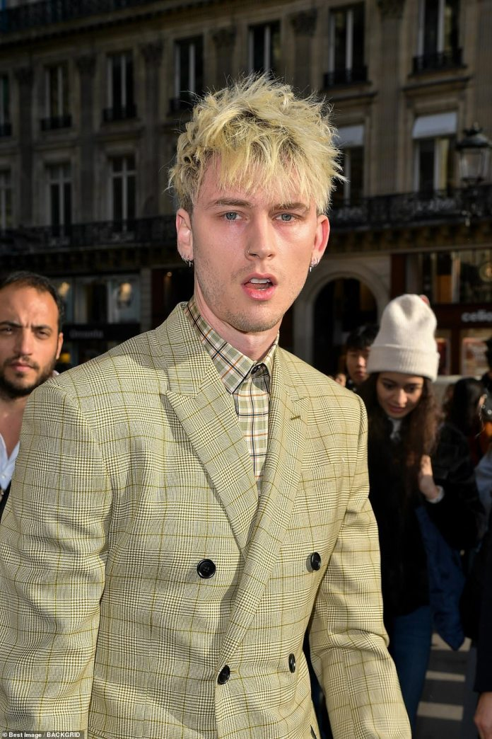 Daring: US rapper Machine Gun Kelly, 29, ensured he made a bold statement in a completely new way as he headed into the fashion show