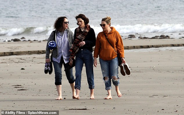 Fun in the sun; Michelle looked casually chic as she spent quality time with her friends