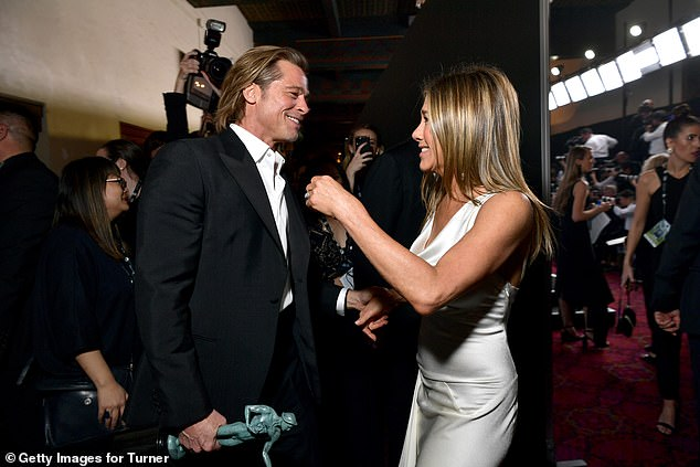 Friendly exes: Brad Pitt (left) and Jennifer Aniston (right) looked truly happy to see one another when they met backstage at the SAG Awards on Sunday
