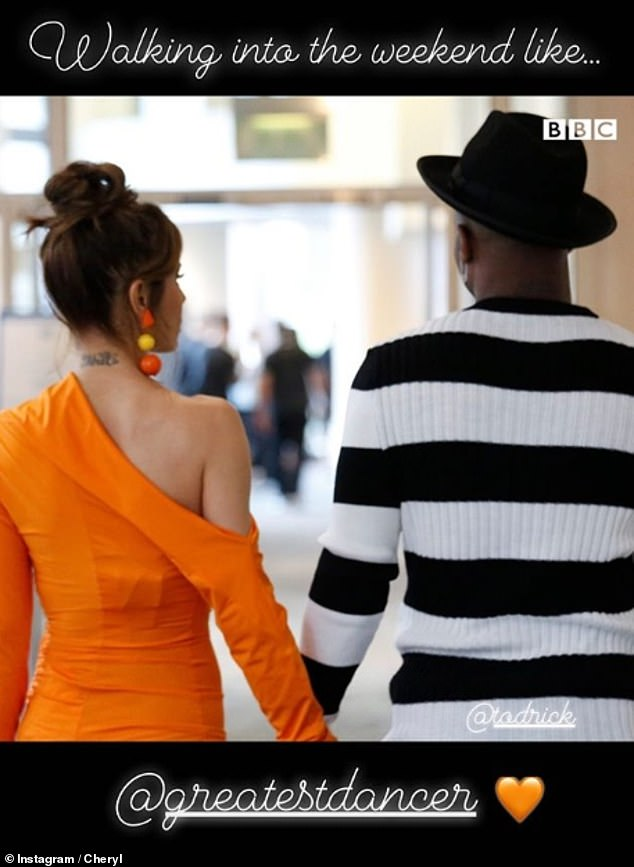 Stunning: The singer accessorised with orange and yellow drop earrings as she held hands with her fellow judge Todrick