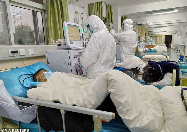 Photos from inside the intensive care unit at Zhongnan Hospital in Wuhan show medical workers caring for critically-ill patients this week