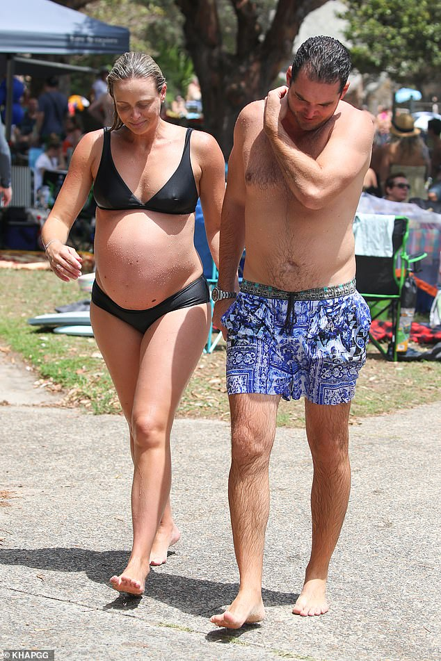 True blue: In true Australian fashion, the duo braved the hot pavement without shoes as they padded over to their belongings through the busy crowds