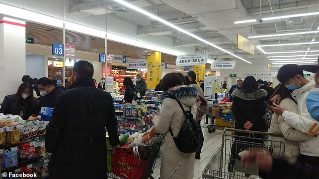 Panicked Wuhan citizens flooded grocery stores in masks amid the lockdown