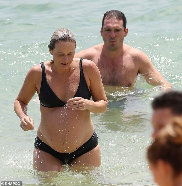 Cooling down: The 33-year-old stripped off into a black bikini for a swim at Nielsen Park beach in Sydney's Vaucluse