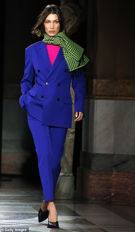 Flawless: Bella walked the catwalk in the colourful blue suit which was teamed with a fuchsia pink blouse