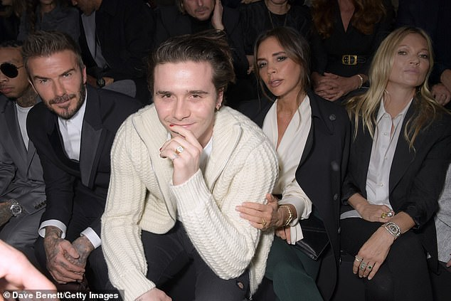 Famous family: Kate, 46 and 17-year-old Lila were joined by David, Victoria and Brooklyn Beckham on the very star-studded front row amid Paris Fashion Week