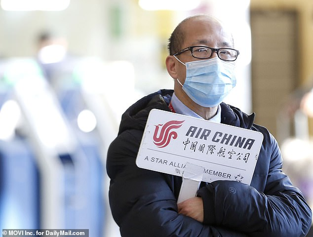 The US Department of State has issued its highest travel warning for Wuhan, advising Americans to not travel to the region. Pictured: A man wearing a mask at Los Angeles International Airport on Friday