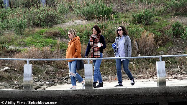 LA life: The group were in good spirits as they walked down to the beach together