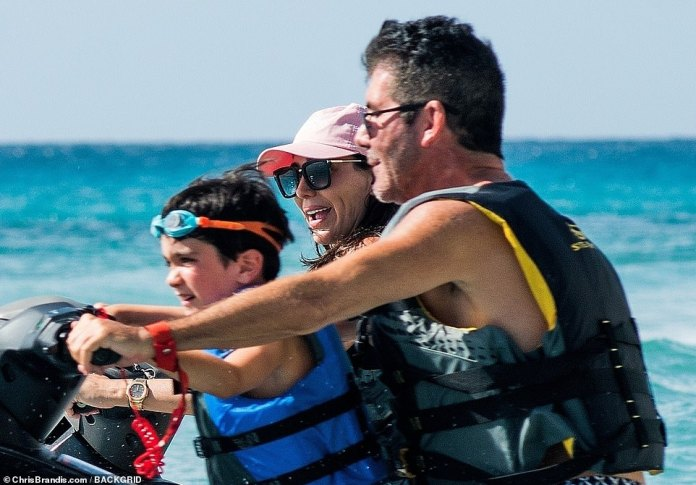 Look at them go! The family can barely contain their glee as they race around on the water