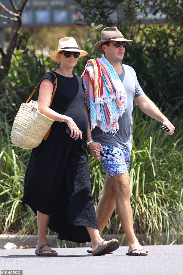 Stylish: Sylvia kept elegantly casual in a black short-sleeve maxi-dress, which accentuated her pregnant figure