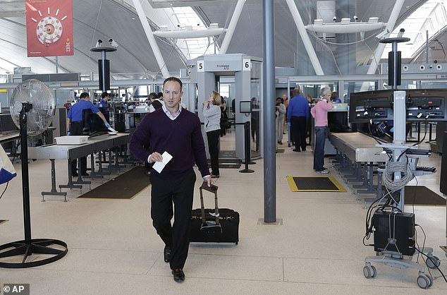 Screenings have also been implemented at New York's John F Kennedy airport (file photo)