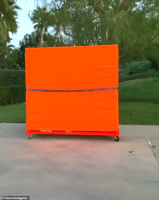 Surprise gift: While Ciara didn't post photos or videos in the pieces, she did Instagram a video of arriving home and finding the large orange wardrobe in her driveway