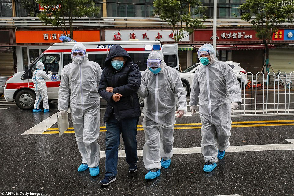HHS Secretary Alex Azar said the US has offered to send medical experts to China three times, but the government has declined. Pictured: Medical staff in Wuhan wear protective clothing and escort a patient (second from left) to a hospital